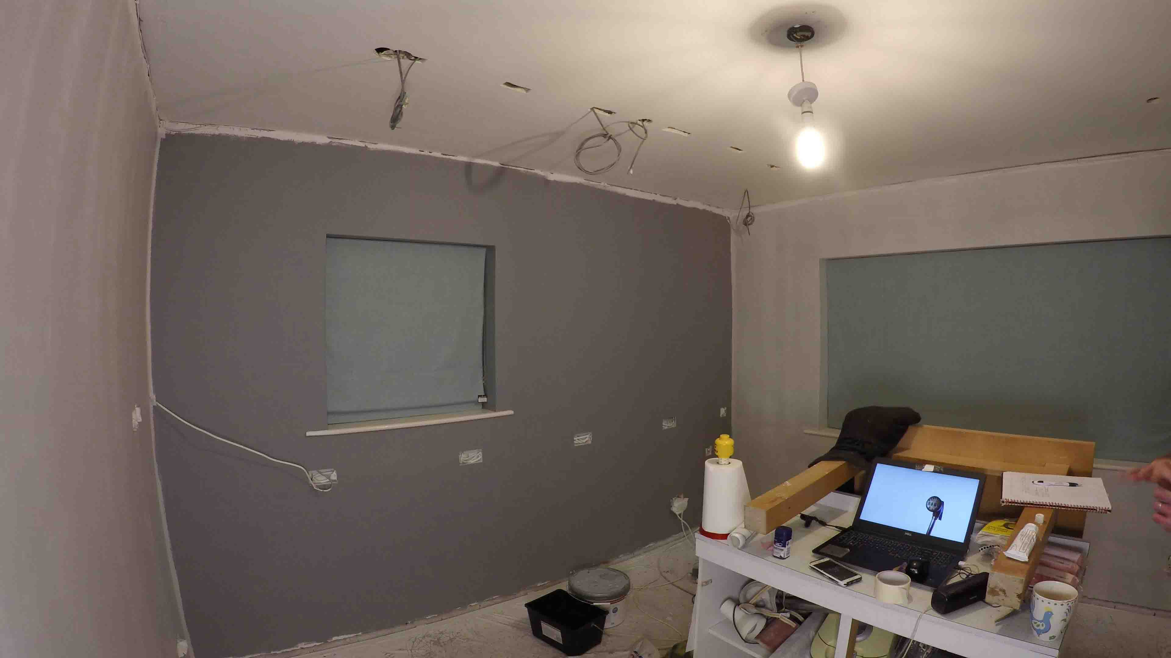 dining room all painted. grey feature wall surrounded by light grey walls