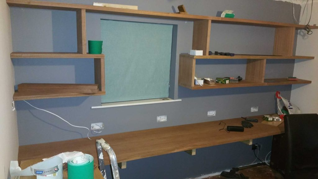 picture of entire shelf and desk wall