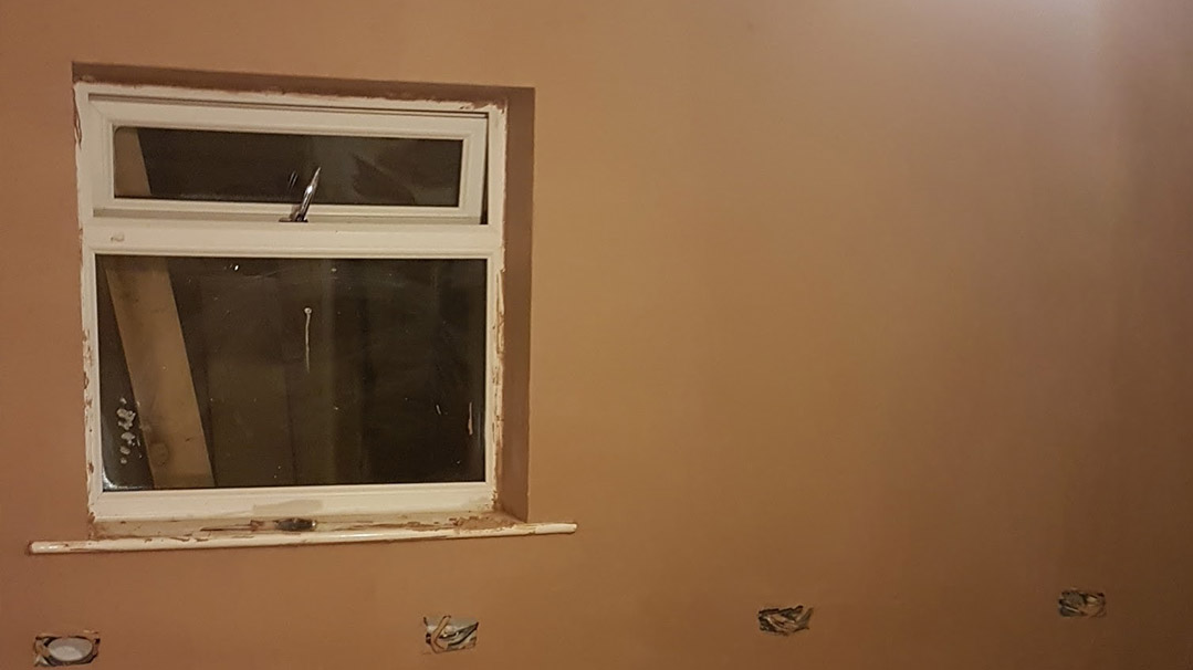 picture showing very neatly finished plaster, sams 4th wall he pastered