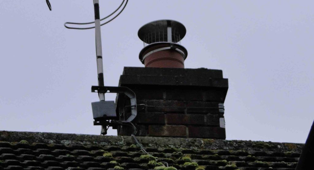 new stainless steel chimney cowl set n top of chimney pot
