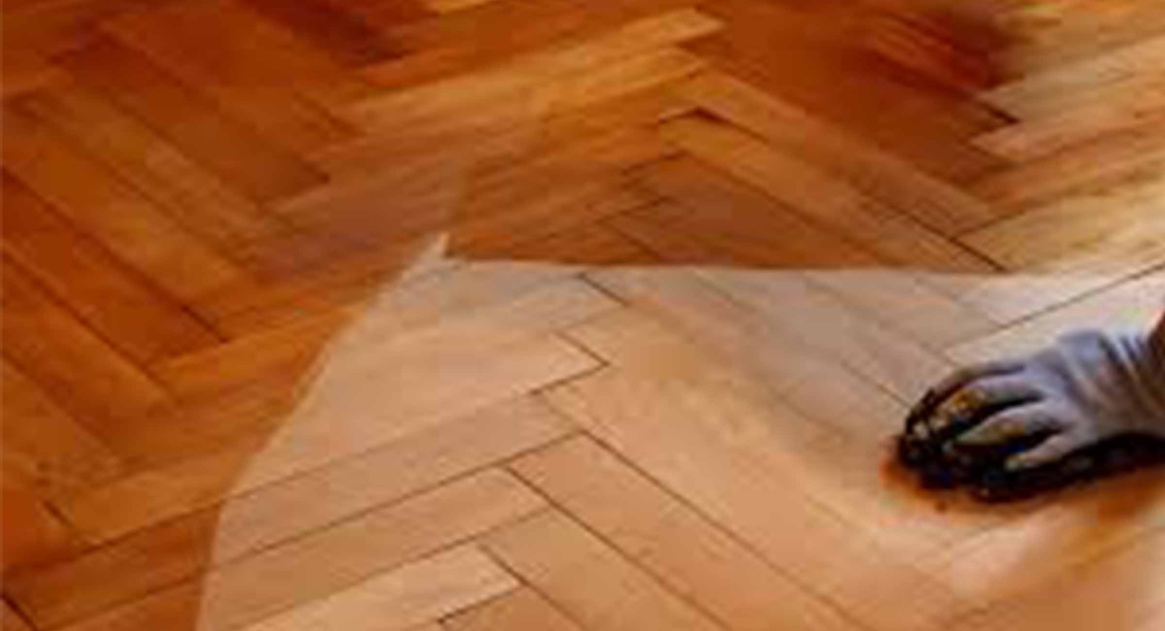 picture showing lacquer being applied to a parquet floor
