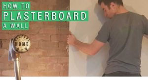 "picture of sam holding up a sheet of plasterboard against a brick wall. title reads ""how to plasterboard a wall"""