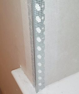 picture showing metal anglebead fixed to plasterboard corner using scrim tape