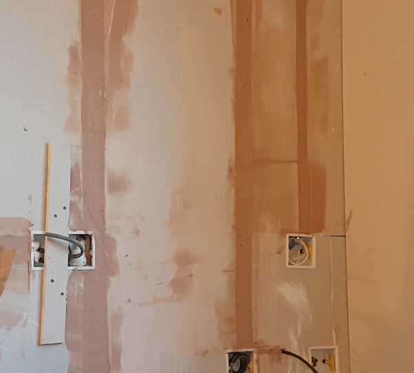 the trunking gaps have been filled with plaster so that it's flush with the adjacent plasterboard