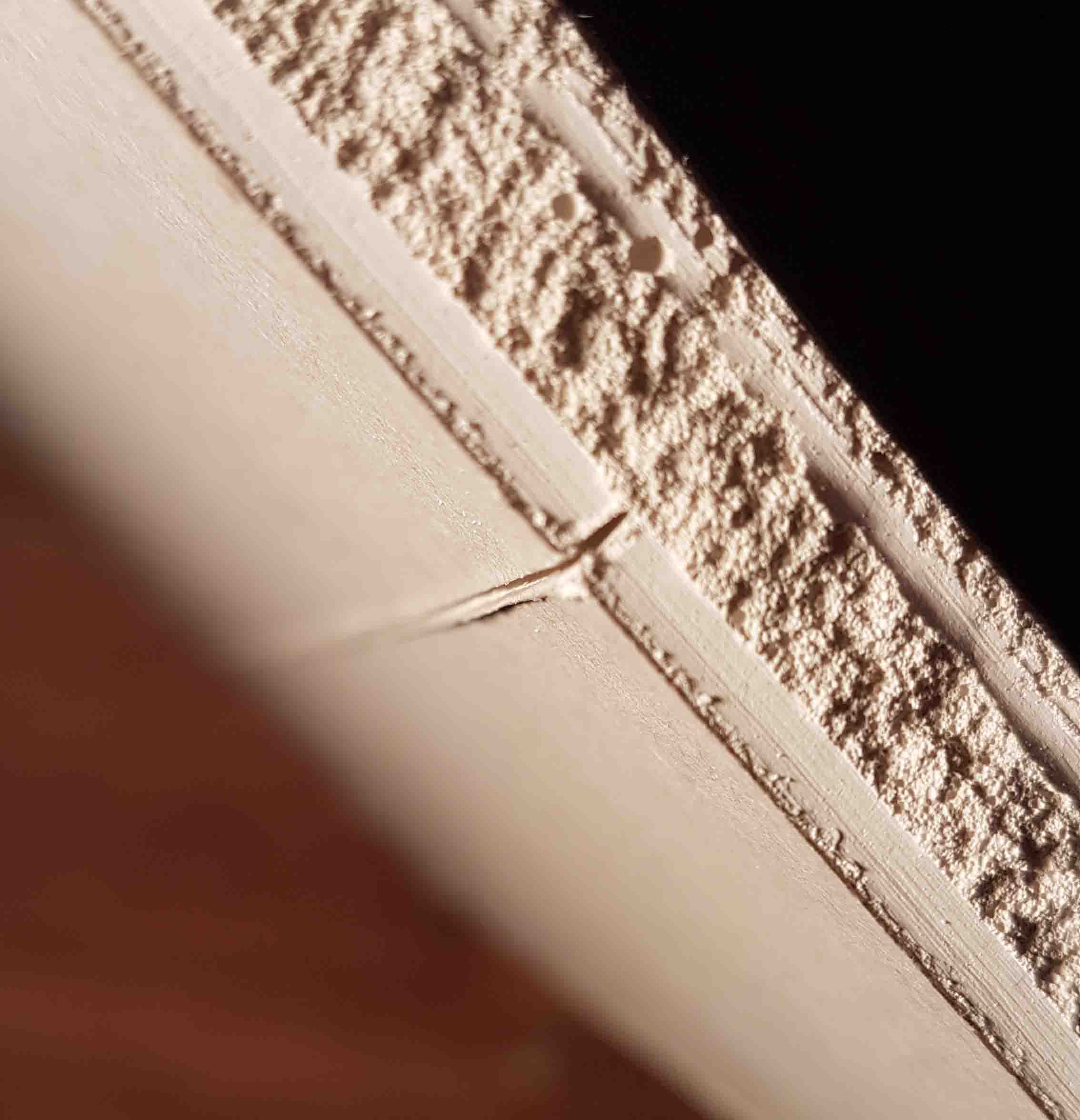 side view on a sheet of plasterboard showing a 1-2mm score line