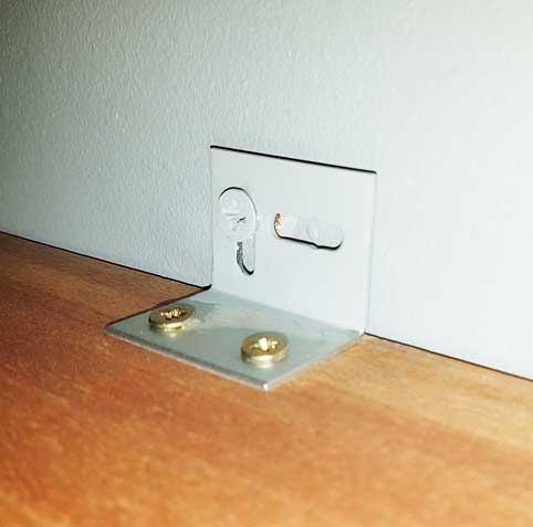picture of L bracket attached to shelf and wall