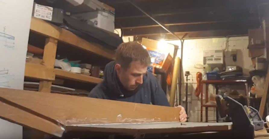 Sam trying to slot the sleighs bottom board into the grooves of the side board