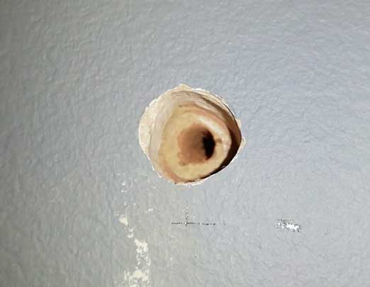 hole cut out in plaster is larger than the masonry cut out beneath, this is for the diy hidden shelf fixing
