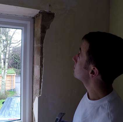 plaster has been removed from the inside of the window recess