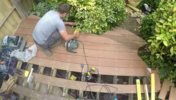 top down view on hardwood decking as sam constructs it