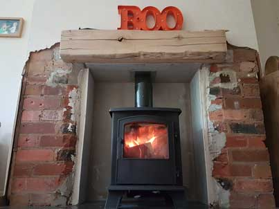 log burner in lounge glowing after installation