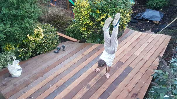 cailtin doing a handstand on the new decking