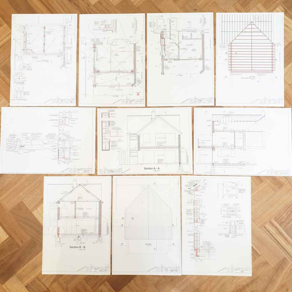 detailed architectural drawings for sams 2 story rear extension are laid out on the floor showing sections, details, plans and elevations