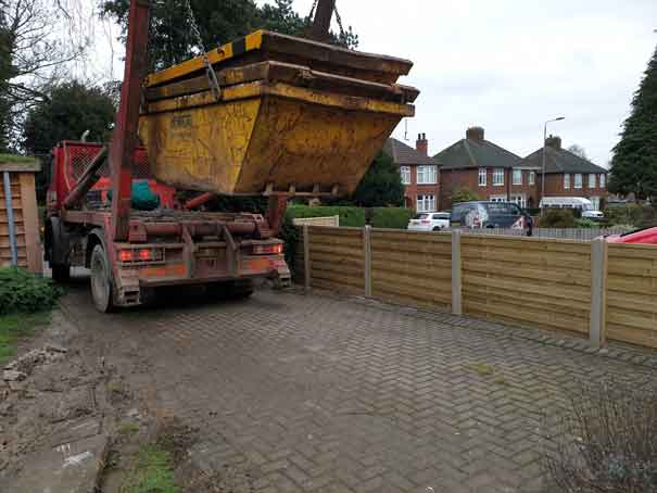 a skip lowering 2 skips onto sams driveway ready for the excavations for foundations